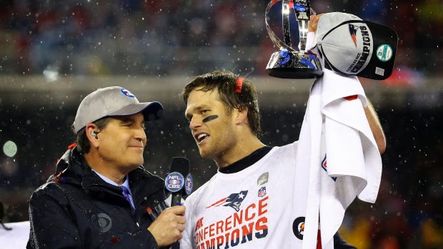 Tom Brady holds the AFC Championship trophy after the Patriots beat the Colts 45 to 7