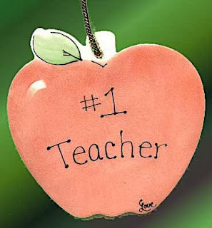 An apple with the words Number One Teacher written on it