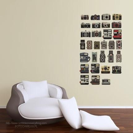 Naklejki na ścianę z motywem aparatu fotograficznego.