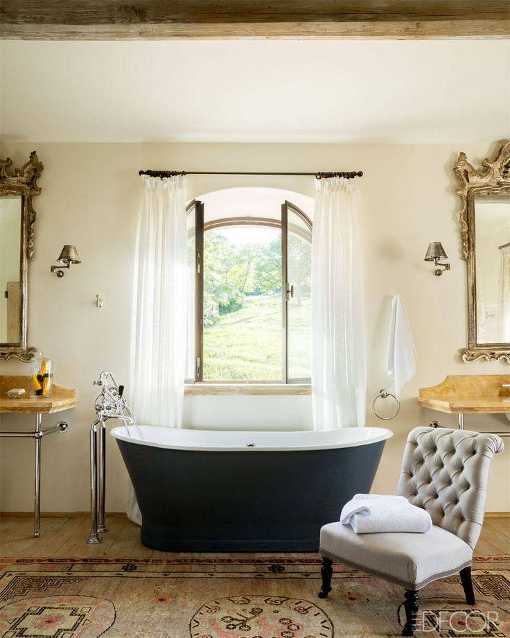 master bath with gray slipper chair