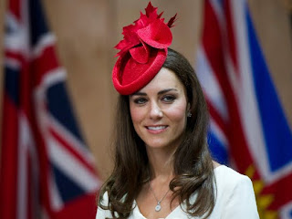 Kate, Duchess of Cambridge, smiles as she take part in a citizenship ceremony at the Museum of Civilization in Gatineau, Canada, on Friday, July 1, 2011.
