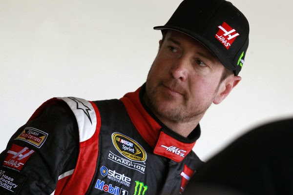 Kurt Busch, driver of the #41 Haas Automation Chevrolet, stands in the garage area during practice for the 57th Annual Daytona 500 at Daytona International Speedway on February 14, 2015 in Daytona Beach, Florida. (February 13, 2015 - Source: Brian Lawdermilk/Getty Images North America)