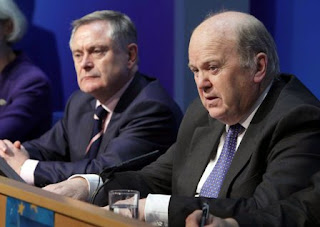 Minister for Public Expenditure and Reform Brendan Howlin and Minister for Finance Michael Noonan at a press conference on Tuesday to discuss the budget.