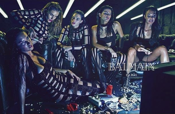 The model appears with Adriana Lima and Rosie Huntington pictures published by Balmain.