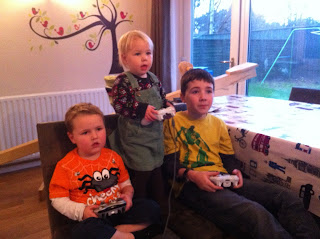 Teaching your brother and sister to play the latest game!