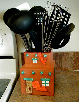 utensil holder - pueblo building design