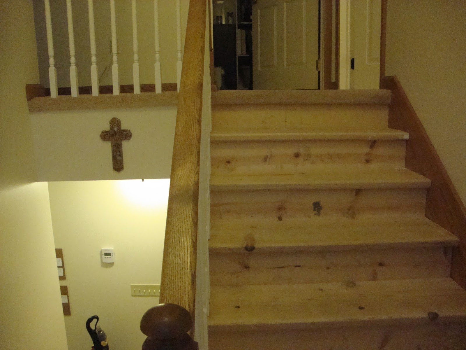 Stair and filling the various nail holes with stainable wood putty