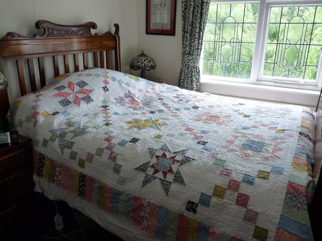 1930's quilt on the bed . . .13 year old UFO .