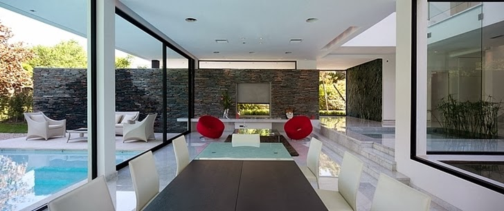 Dining room in Minimalist Casa Carrara by Andres Remy Architects