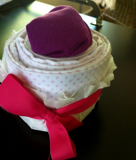 A Lady and Her Englishman Baby Clothes Cupcakes