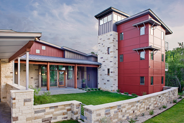 Picture of contemporary ranch house with stone facade and small lawn in front of the house