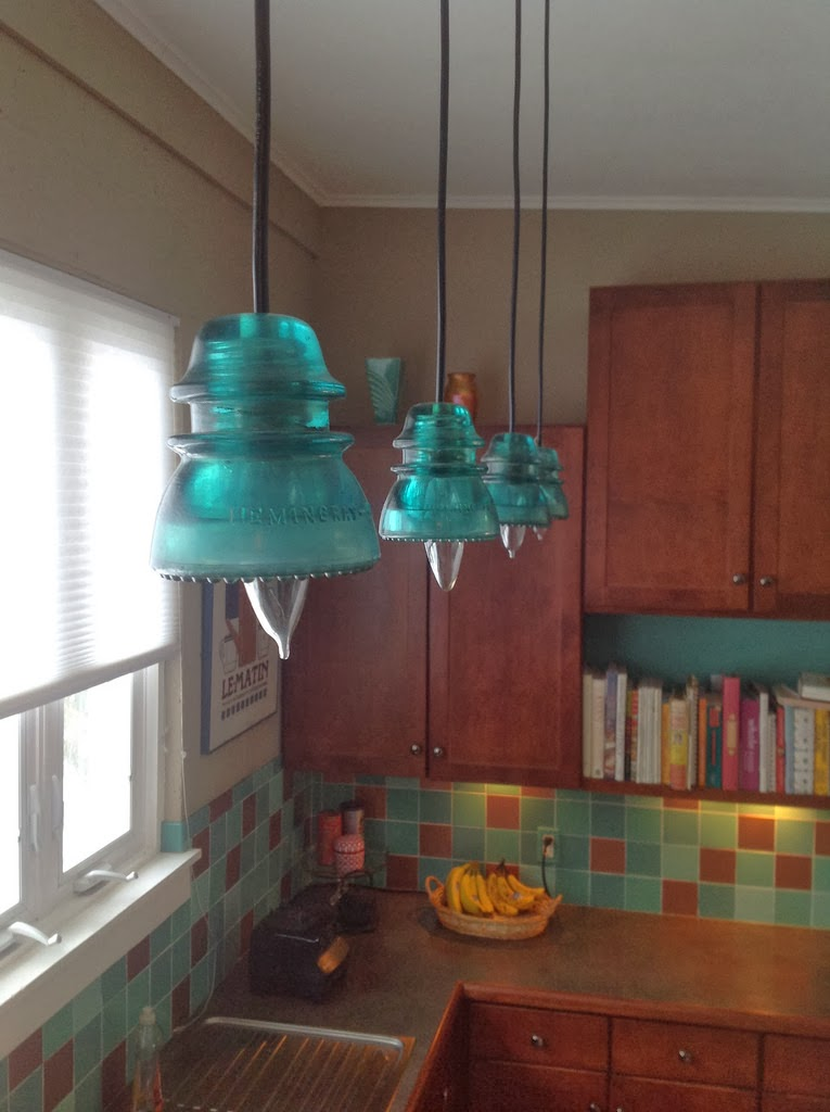 Mybluehaven glass insulator pendant lights when we bought our house the kitchen came with some pendant lights that we really didnt care for there were four of them of varying lengths aloadofball Choice Image