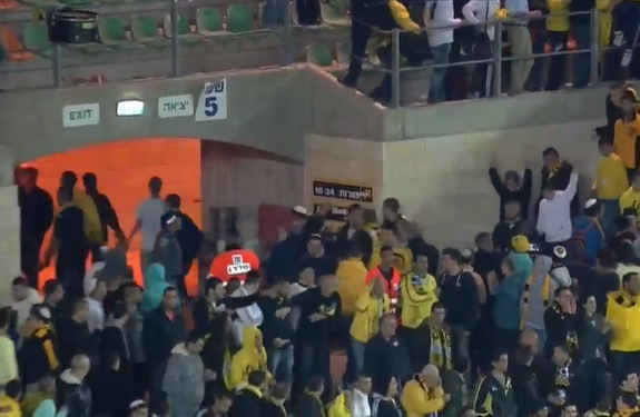 Around 300 fans of Beitar Jerusalem leave the stadium once Zaur Sadayev scored for their team