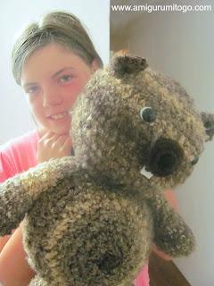 girl holding stuffed beaver toy