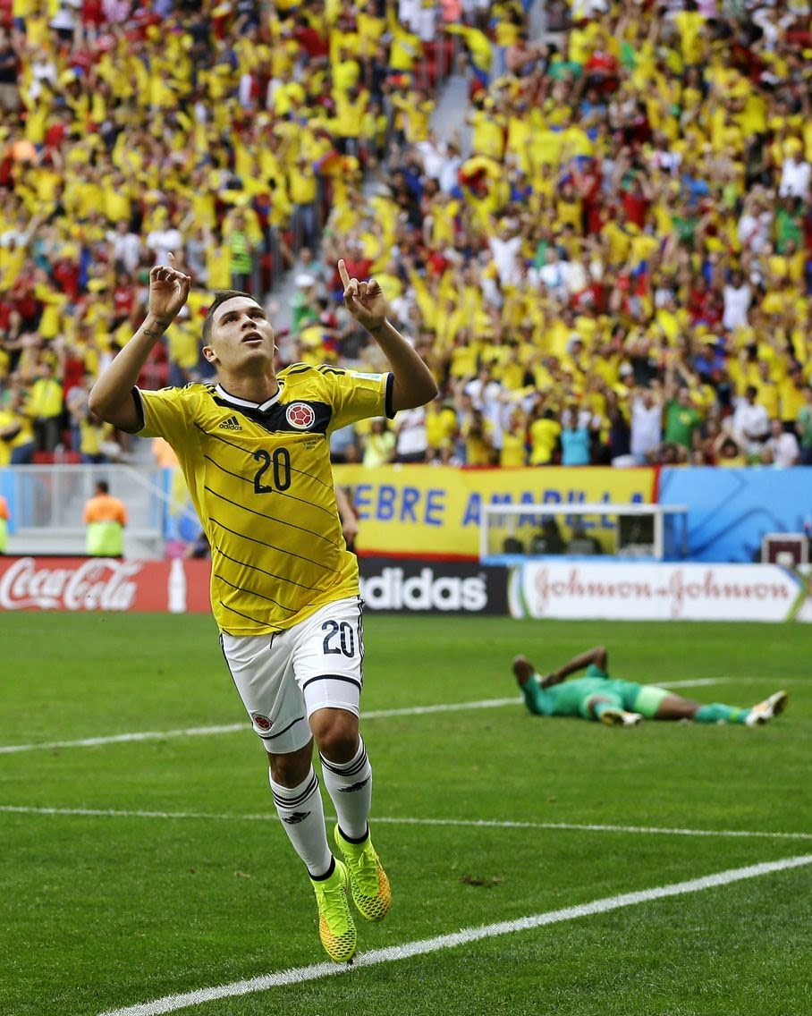 Colombia's Juan Quintero, left, celebrates after scoring his side's second goal against Ivory Coast's goalkeeper Boubacar Barry during the group C World Cup soccer match between Colombia and Ivory Coast at the Estadio Nacional in Brasilia, Brazil, Thursday, June 19, 2014.