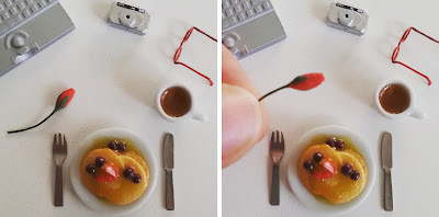 Two flat-lay instagram photos of a dolls' house miniature pancake breakfast surrounded by a laptop, digital camera, reading glasses and a mug of coffee. In the left photo there is a rose bud on the table, in the right one it is being held up to show how small it is.