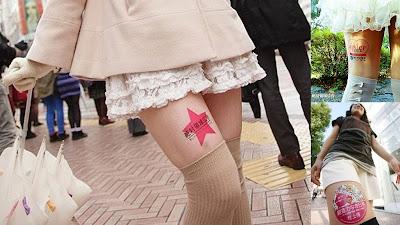 Japão inova em marketing divulgando anúncios nas coxas de jovens mulheres.