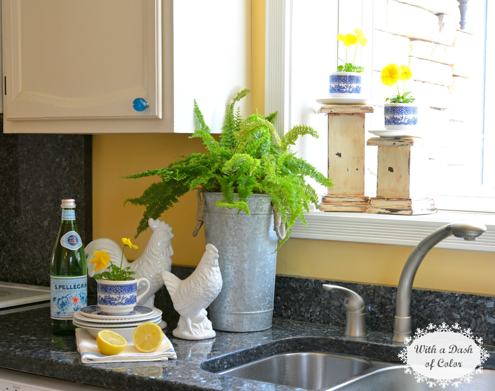 With a dash of color decorating the kitchen window sill for Kitchen window sill decoration ideas