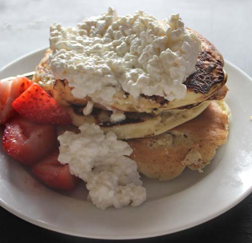 Pancakes Topped with Cottage Cheese and Strawberries