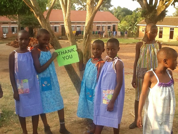 These children are showing off their new dresses from the Little Dresses For Africa charity - 99-Year-Old Lady Sews A Dress A Day For Children In Need
