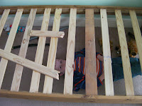 boy under bed broken slat mended with pallet