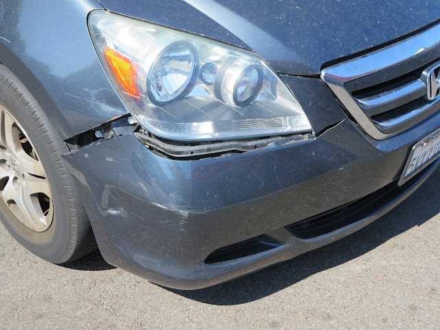Cracked bumper and dented fender before repair at Almost Everything Auto Body