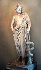 Statue of Greek god of medicine  Asclepious holding his  snake-entwined staff.