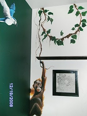 Orangutan swinging on vine