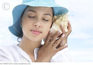 Young Woman Listening to Seashell 42 17092837 تعرف على سبب سماع صوت المحيط في القواقع