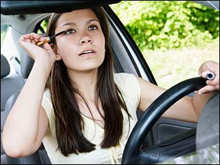 putting on makeup while driving