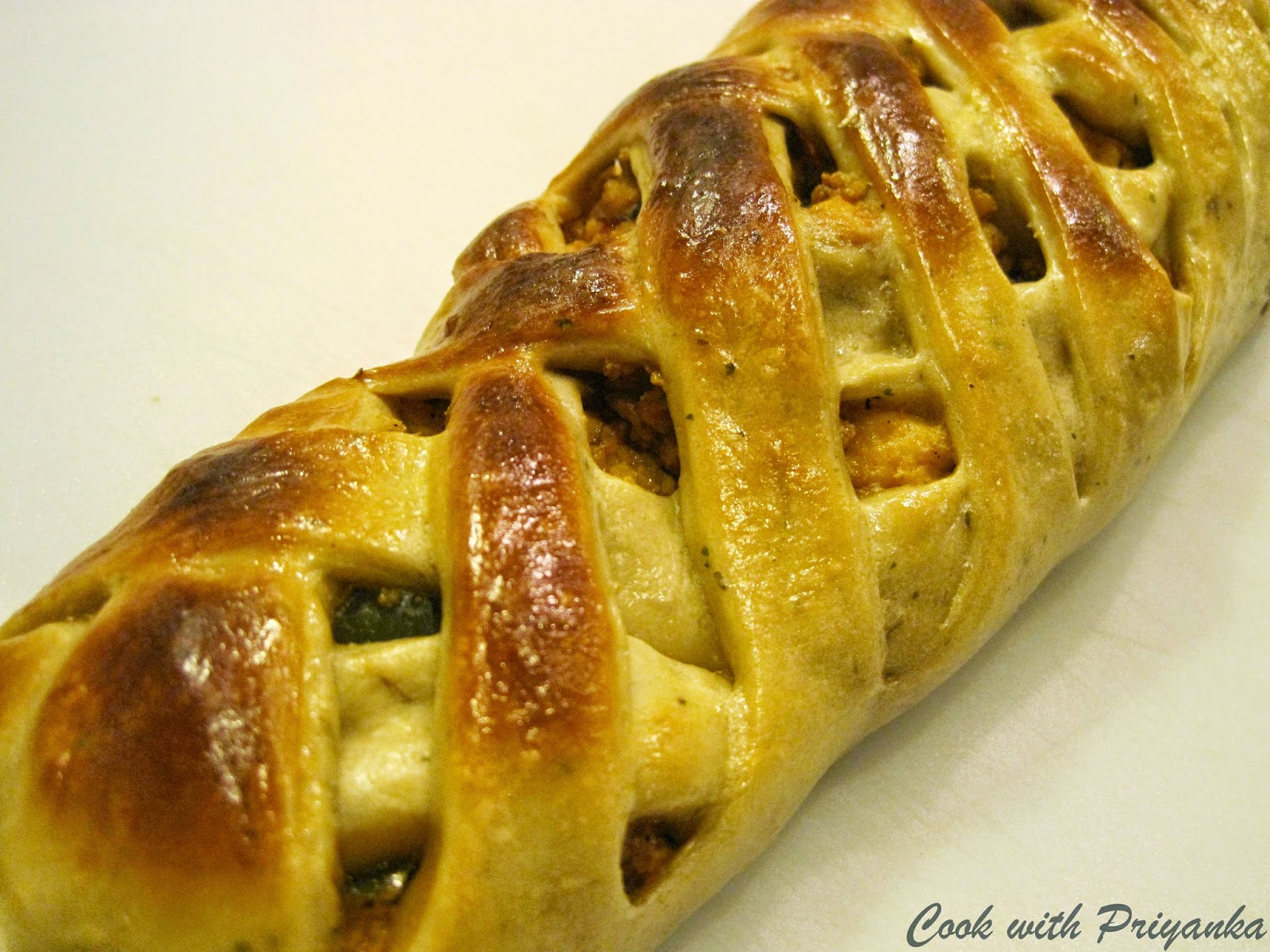http://cookwithpriyankavarma.blogspot.co.uk/2014/06/braided-bread-stuffed-with-paneer.html
