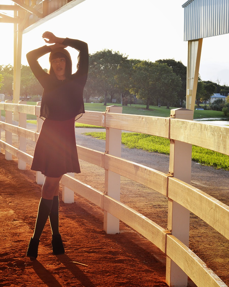 Indie Fashion Blogger Anais Alexandre of Down to Stars in collaboration with Skechers wearing girls club sisterhood show with an h and m top and urban outfitters dress at an equestrian center for fall fashion