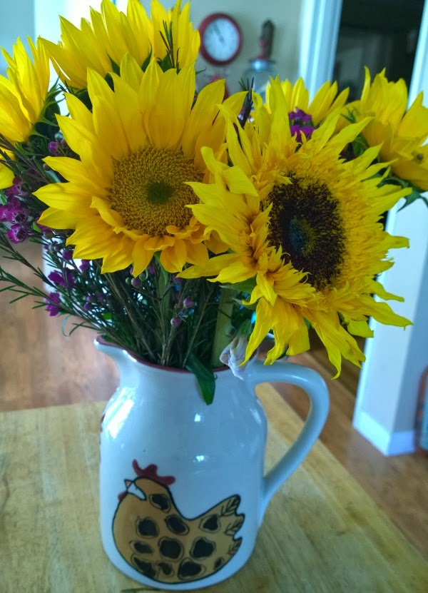 Sunflowers in a rooster jug #sunflowers