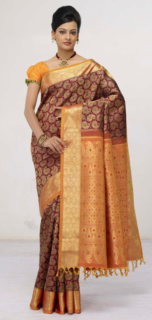 Marriage Sarees,Marriage saree,Sarees,Saree,wedding sarees, kanchipuram silk sarees,Kanch Pattu Saree,New Indian Designer Collection of Bridal Sarees ,Cotton Sarees, Cotton Designer Saris,Cotton Sarees,bridal saree, wedding sari, party wear sarees, traditional indian sarees like zari, silk, printed,A perfect example of a traditional kanchipuram sari with a traditional look..yet elegant and stylish. I would love to accesorize like the lady in the picture above if I wear a Kanchipuram sari.. The pallu of this sari is really gorgeous with a lady standng in a red sari all hand woven and this sari is a very expensive one..I guess it costs more than  I simply adore this sari for its beautiful combination of colour, Orange and purple I'm still hunting for this combination but could not get the exact combination. This is simply adorable!!! another sari from RMKV silks.  This is a readymade sari for your little angel. This is a pure kanchipuram silk sari customized as a ready to wear outfit for small kids. I'm sure your little one's will be excited to wear this kutti pattu.. means saree for kid  The sari above is called the muppagam pattu the latest trend in Kanchipuram saris. You can see the border of the sari and the body in almost the same width. This sari is from Mahaveers a popular shop in Coimbatore THIS ONE IS A GADHWAL SILK, MY FAVOURITE BLUE.MY MOM IN LAW GIFTED ME. Sarees are the elegant and the sexiest outfit for Indian women. A lady looks very graceful and elegant in a saree.There are wide range of sarees in different materials and designs and work. The designer crepe,georgette and chiffons are popular these days and when it comes to a formal occassion my personal choice definitely would be traditional sarees specially kanchivaram sarees.One can choose kanchivaram sarees as per their own taste.The variety ranges from simple,elegant sarees to a very grand saree and the price range vary with the zari work in the saree. A simple saree with minimum zari work will cost any where between 3000 to 4500 INR, and the maximum range goes beyond 60,000 and sky is the limit.But one can definitely buy a good elegant saree with price range anywhere between 5000 to 10,000INR.Nowadays one can buy a plain kanchivaram saree without any zari work and one can design as per their taste.There are ladies in Chennai to design these kind of sarees as per their customer's choice.One can customize these plain sarees with kundan,zardoshi or any other design one prefer.But my personal choice  would be the traditional kanchivaram saree with it's zari work.They have their own grace.There are kanchivaram silk skirts available for cute little girls and teenage girls.If you have a girl baby you should definitely try these skirts and I swear your child will look like goddess lakshmi in this outfit.Teenage girls can wear half saree and blouse with kanjivaram silk skirt when they go for a formal function and can wear simple gold bangles, a choker and a pair of jhumkas and can wear asimple tikka(netthi chutti), definitely you will get loads of compliments for sure.For ladies wearing saree they can wear traditionalstonned necklace like ruby,emerald and blue sapphire to match your saree or there are wide range of 1 gram gold ornaments available in the market and you can choose from that according to your budget.I will give a list of names of shops from wher you can purchase good kanchivaram sarees,gold jewellery and artificial and one gram jewellery