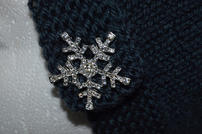 snowflake button on hand knit hat available for sale