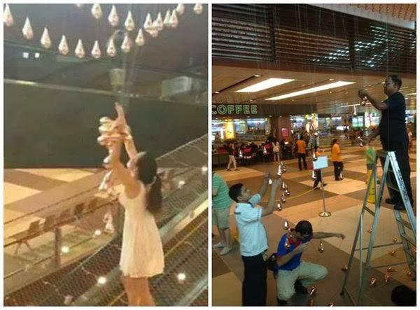 changi airport kinetic rain woman