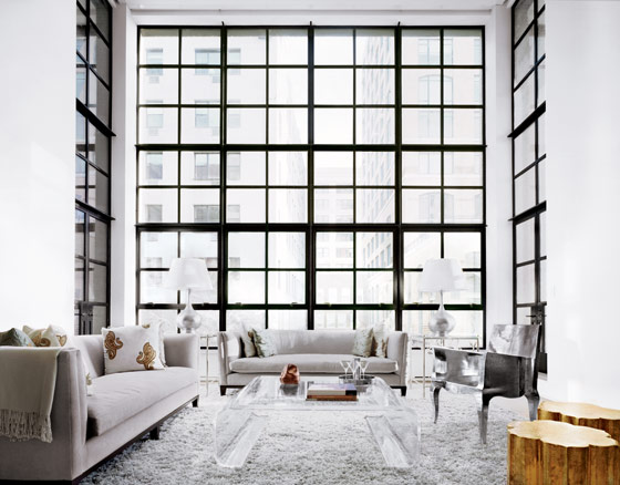 New York City Apartment floor to ceiling windows modern super high ceiling shag rug grey sofa