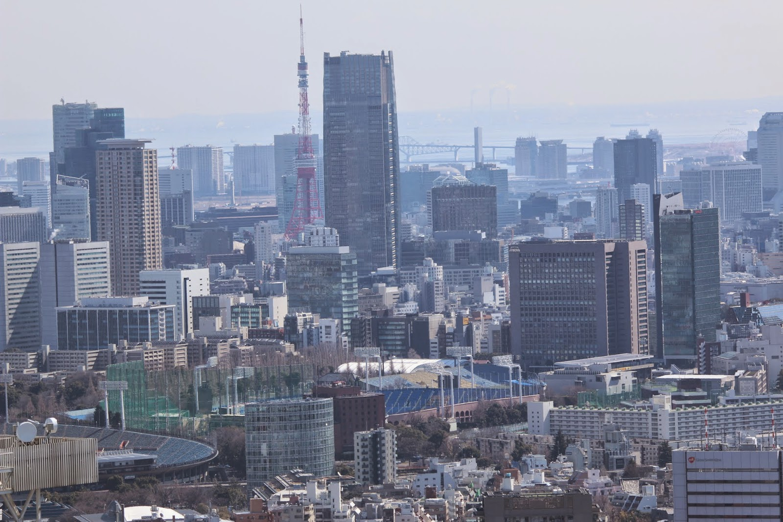 Tokyo Tower can be seen at the observation deck of Tokyo Metropolitan Government Building in Shinjuku Business District of Tokyo, Japan