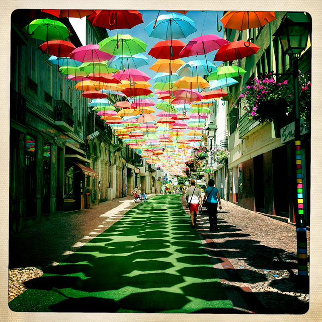 umbrellas at sky of a street in agueda portugal