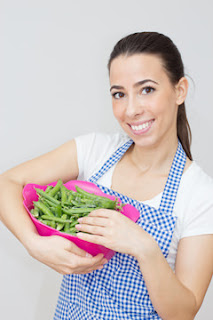 Woman holding a Bunch of Peas