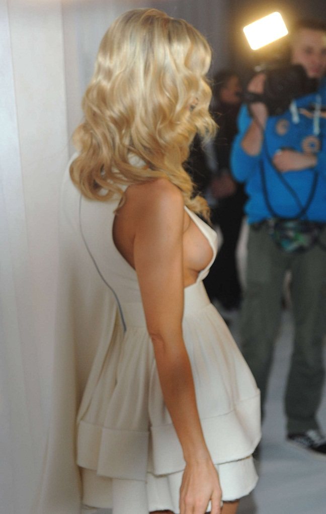 Joanna Krupa flashes sideboob during fashion show in Poland