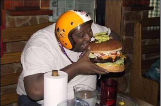 funny pictures: fat afro-american with hamburger