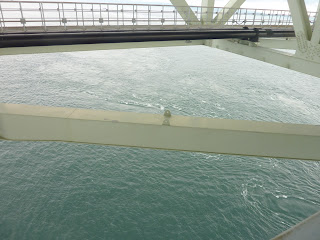 Looking down towards water from the maintainance pathway under the Akashi Kaikyo Bridge (50m about the sea), another pathway is visible at the top of the image