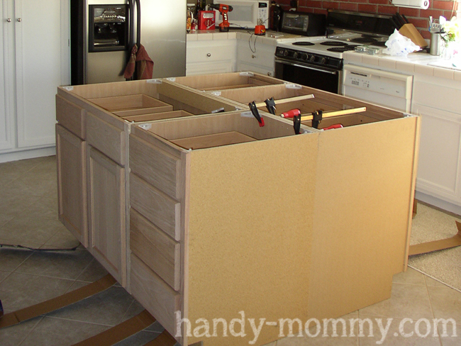 Handy mommy diy kitchen island step 3 use wood screws and screw the cabinets to each other use lots of screws hows that for a specific instruction haha solutioingenieria Gallery