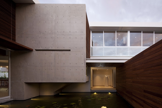 Pond and modern facade of FF House in Mexico
