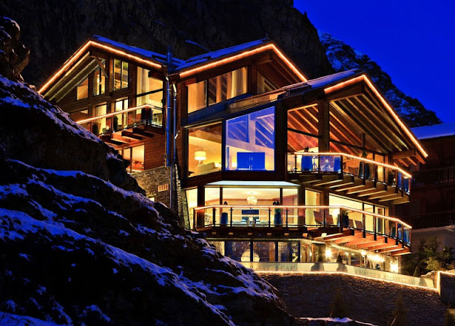 Picture of large mountain home at night