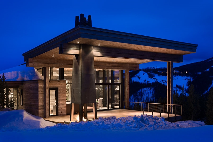 Facade of Elegant Mountain Home by Reid Smith Architects at night
