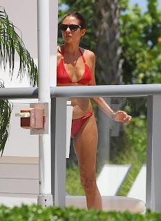 Olga Kurylenko in red bikini and sunglasses