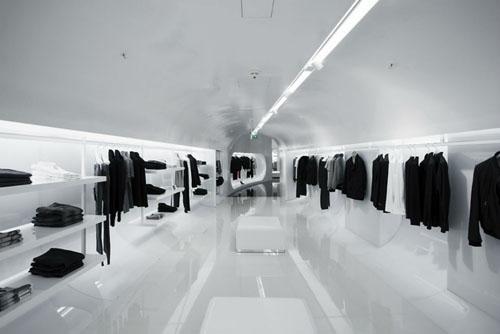 Capsula the Elegant Fashion Store Design white interior