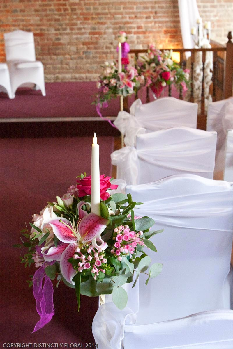Distinctly floral aimee and darrens striking cooling castle barn for the wedding breakfast we provided mini martini vases for the top table along with a low central arrangement we also added hot pink and clear crystals floridaeventfo Images